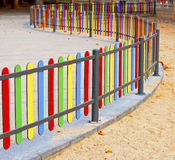 Colourful rows of painted wood on a playground fen Stock Photo