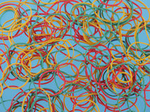 Colourful rubber bands on a blue background Royalty Free Stock Photo