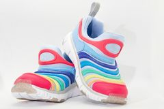 Colourful running shoes on white background royalty free stock photos