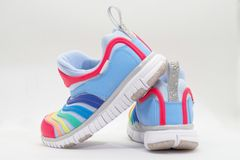 Colourful running shoes on white background,rear view royalty free stock photography