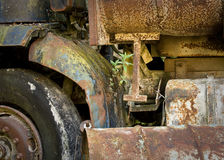 Colourful, rusty, abandoned lorry. An abandoned lorry rusts away showing many different colours of decay Stock Image