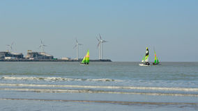 Colourful sailing boats in front of Port of zeebrugge Royalty Free Stock Photo