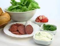 Colourful sandwich ingredients. Sandwich ingerdients: salami, tzatziki, parsley, radish, lettuce and ballbread put together Royalty Free Stock Image