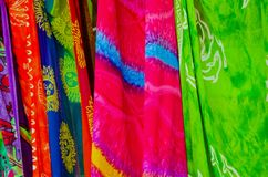 Colourful Sarongs hanging by a beach Stock Photos