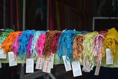 Colourful scarves line a shop window Royalty Free Stock Photography