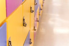 Colourful School Lockers. In yellow, blue and purple royalty free stock photography