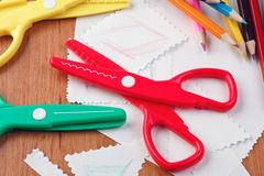 Colourful scissors and crayons. On table Stock Photo