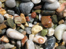 Colourful Sea Pebbles. Wet, sparkling, and full of colours sea pebbles stock photos