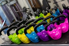 Colourful set of Kettlebells sitting on a rack stock photo