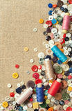 Colourful sewing buttons and spools of threads with copy space Royalty Free Stock Photos