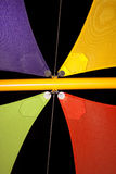 Colourful shade sails against night sky. Brilliantly coloured shade sails against the black of night Stock Images