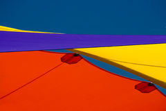 Colourful shade sails. Red yellow and purple shade sails stock photo