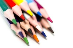 Colourful sharp pencils lie on a white background stock photo
