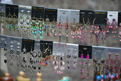 Colourful shinny earrings at the Nothinghill`s market stock photo
