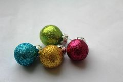 Colourful shiny Christmas baubles Royalty Free Stock Photos