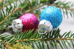 Colourful shiny Christmas baubles Stock Image