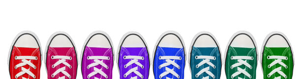 Colourful sneaker shoes. Multi brightly colored  plimsoll sneakers shoes  white background Stock Photography