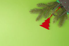 Colourful shopping bag, christmas tree branch and decoration on greenery background. Xmas gifts, shop, sale concept. Top Stock Image