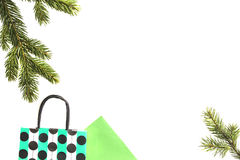 Colourful shopping bags and christmas tree branch on white background. Xmas gifts, shop, sale concept. Top view. Flat. Colourful shopping bags and christmas tree Royalty Free Stock Image