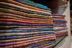 Colourful silk scarfs. Hanging at a market stall stock image