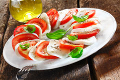 Colourful slices of cheese and tomato Stock Photos