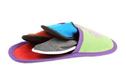 Colourful slippers into big slipper. Royalty Free Stock Photos
