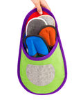 Colourful slippers into big slipper Stock Photos