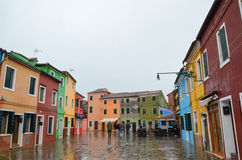 Colourful small houses on a rainy day in Burano island, Venice, Italy. March 3, 2016 Stock Photo