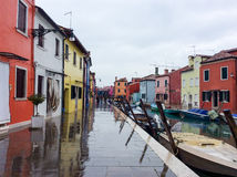Colourful small houses on a rainy day in Burano island, Venice, Italy. March 3, 2016 Stock Image