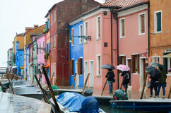 Colourful small houses on a rainy day in Burano island, Venice, Italy. March 3, 2016 Royalty Free Stock Images