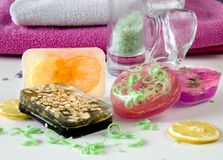 Colourful soap bars. Towels at background royalty free stock photos