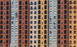 Colourful Social Housing tower block facade Murcia Spain. A head on view of social housing - colourful flats or apartments sunlit. Situated in Mucia, Spain Stock Photography