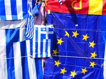 Colourful Greek and European Union Flags, Plaka, Athens, Greece. Colourful souvenirs, European Union and blue and white Greek National flags, on display outside royalty free stock images