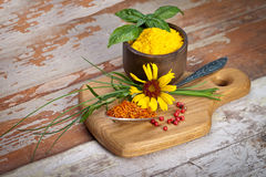 Colourful spices in bowls spilling onto an old aged scored woode Royalty Free Stock Photography