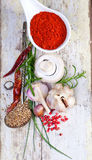 Colourful spices in bowls spilling onto an old aged scored woode Royalty Free Stock Image
