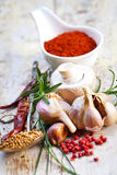 Colourful spices in bowls spilling onto an old aged scored woode Stock Images