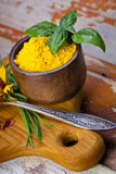 Colourful spices in bowls spilling onto an old aged scored woode Stock Photo