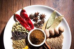 Indian Garam Masala powder / Indian spice mix. Colourful spices for Garam Masala. Food ingredients for garam masala, indian spice mix with Powder. Selective Stock Photos