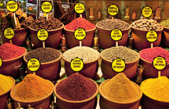 Colourful spices with labels Royalty Free Stock Images