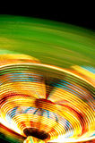 Colourful spinning fun fair light trail Royalty Free Stock Photography