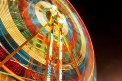 Colourful spinning fun fair light trail Royalty Free Stock Photos