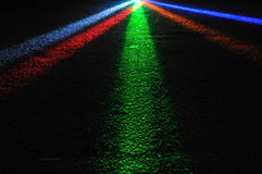 Colourful Spot Lights. Beams of coloured spot lights shining on the floor royalty free stock images