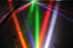 Colourful Spot Lights. Beams of coloured spot lights shining on the floor stock photography