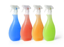 Colourful spray cleaners. Isolated on white background Royalty Free Stock Images