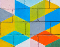 Colourful square painted on grunge wall Royalty Free Stock Images