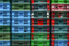 Colourful stack of fish crates on a vessel Stock Photos