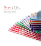 Colourful Stacked DVD Cases. Colourful stacked plastic DVD cases on a white surface. Copy space Stock Images