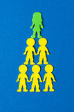 Colourful stacked  foam people on blue background Royalty Free Stock Images