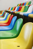 Colourful stadium seats Stock Images
