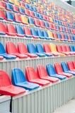 Colourful stadium seats Stock Images
